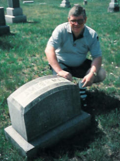 Steve Man at the Gravestone of James Henry Man
