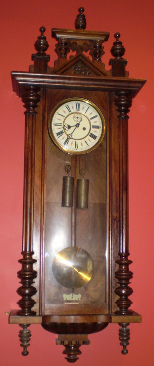 Chas L. Reis Clock on wall